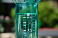 Filled rain gauge Stock Photo