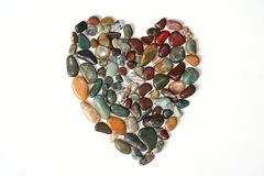 Filled Rock Heart. A mosaic heart created from polished stones and gems Stock Image