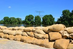 Filled sandbags as protection against floods Stock Photo
