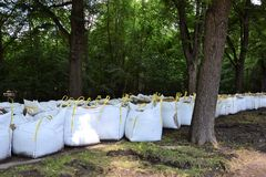 Filled sandbags as protection from the flood Stock Photo