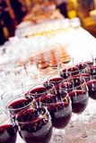 Filled stemware. Filled glasses on the table in a restaurant Stock Photos