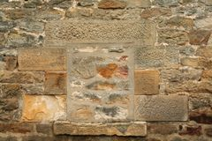 Filled in window. Old stone building had no need for a window the space was filled in with stones royalty free stock image