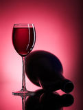 Filled wine glass and pitcher Royalty Free Stock Image