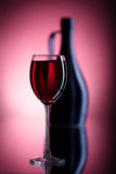 Filled wine glass and pitcher Royalty Free Stock Images