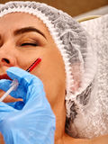 Filler injection female face. Plastic facial surgery in beauty clinic. Stock Photography