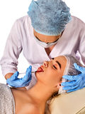 Filler injection for female face. Plastic facial surgery in clinic. Stock Photos