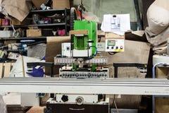 Filler machine to make furniture at carpenters workshop. Stock Images