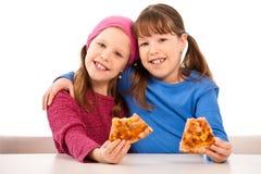 Filles avec la pizza Images stock