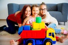 Filles avec le camion de jouet Photo libre de droits