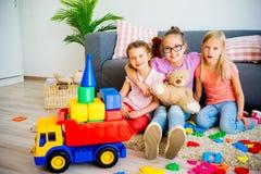 Filles avec le camion de jouet Photos libres de droits
