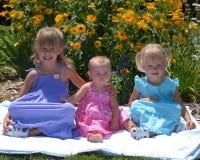 Filles dans des robes en fleurs Images libres de droits