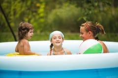 Filles dans la piscine Photographie stock libre de droits