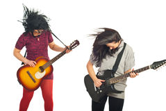 Filles de bande de Rockstars avec des guitares Photographie stock libre de droits