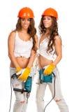 Filles de Gémeaux avec un foret électrique Photo libre de droits