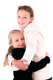 2 filles de l'adolescence sur un fond blanc Photos stock
