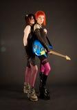 Filles de roche avec la guitare basse Photos stock