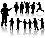 Filles et garçons de silhouette de vecteur Photos libres de droits