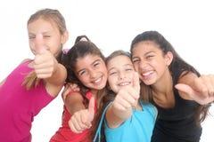 Filles heureuses affichant des pouces vers le haut Images stock