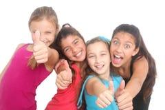 Filles heureuses affichant des pouces vers le haut Image stock