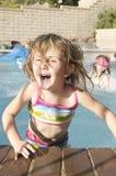 Filles heureuses dans la piscine Photo libre de droits