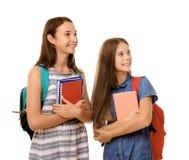 Filles mignonnes d'adolescent tenant des carnets, d'isolement sur le blanc Photo stock