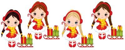 Filles mignonnes de vecteur petites avec des bâtons de sucrerie, des traîneaux et des boîte-cadeau de Noël Photos stock