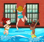 Filles plongeant et nageant dans la piscine illustration stock