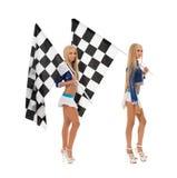 Filles sexy posant avec des drapeaux Concept de course Photo stock
