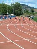 Filles sur le fini 100 mètres de tableau de bord Photo libre de droits