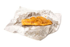 Fillet of battered deep fried cod. Royalty Free Stock Images