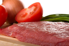 Fillet of beef. With tomato and onion closeup Royalty Free Stock Image
