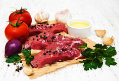 Fillet of beef. And ingredients on a old wooden background Stock Photo