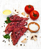 Fillet of beef. And ingredients on a old wooden background Stock Photos