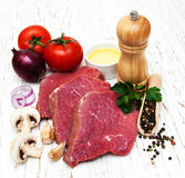 Fillet of beef. And ingredients on a old wooden background Royalty Free Stock Photos