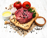 Fillet of beef. And ingredients on a old wooden background Stock Image