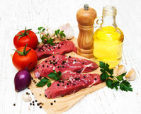 Fillet of beef. And ingredients on a old wooden background Stock Photography