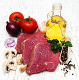 Fillet of beef. And ingredients on a old wooden background Royalty Free Stock Image