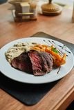 Fillet of beef with mushroom sauce and potatoes stock image