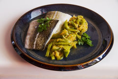 Fillet of cod with vegetables. Royalty Free Stock Photo