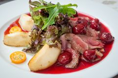 Duck breast with cherry sauce. Stock Images