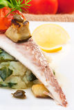Fillet of Fish. Gilt-head bream filet on potato with chard stock photo