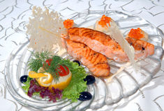 Fillet of fish with red caviar Stock Images