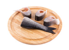 Fillet of fresh raw fish on a cutting board. Isolated on a white background Stock Photos