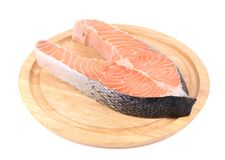 Fillet of fresh raw fish on wooden board. Isolated on a white background Royalty Free Stock Image