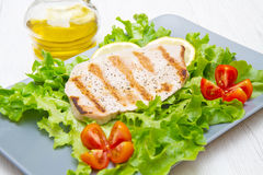 Fillet of grilled tuna with salad and tomatoes Stock Photo