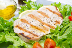 Fillet of grilled tuna with salad and tomatoes Royalty Free Stock Image