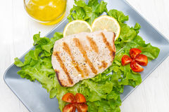 Fillet of grilled tuna with salad and tomatoes Royalty Free Stock Photo