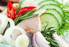 Fillet of a herring with cucumbers Stock Photo