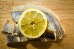 Fillet herring with lemon. Herring are very high in the long-chain Omega-3 fatty acids EPA and DHA. They are a source of vitamin D Stock Photos
