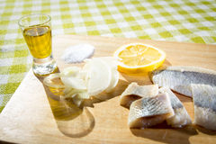 Fillet herring with onion and lemon. Fillet herring with lemon. Herring are very high in the long-chain Omega-3 fatty acids EPA and DHA. They are a source of Royalty Free Stock Image